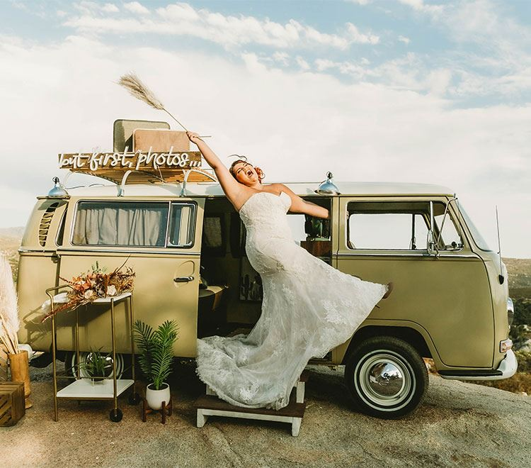 Plus Size Bride Wearing A Wedding Dress On Top Of A Van. Mobile Image.
